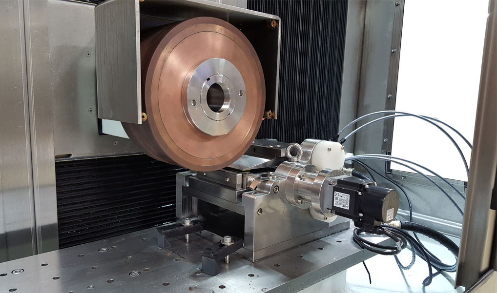 The PGS-100 ECG Point Grinding System.